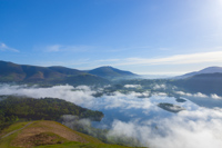 Early morning Mist over Derwent Water from Cat Bells with Blencathra in background.