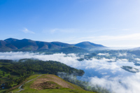 Early morning Mist Derwent Water, Skiddaw & Blencathra from Cat Bells, Cumbria, England.